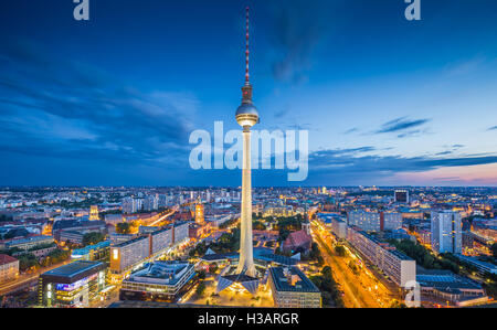 Berlin skyline with famous TV tower at Alexanderplatz in twilight at dusk, Germany - Stock Photo