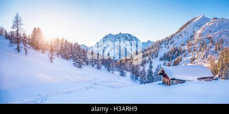 Panoramic view of beautiful winter wonderland mountain scenery with traditional mountain cabin the background in - Stock Photo