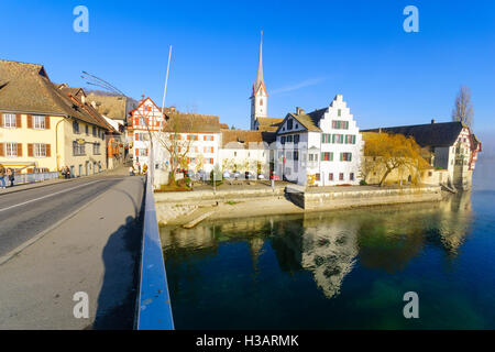 STEIN AM RHEIN, SWITZERLAND - DECEMBER 26, 2015: View of the village and the Rhine River, with locals and visitors, - Stock Photo