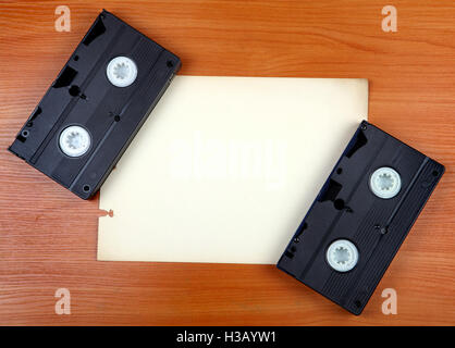 Video Tapes on the Board - Stock Photo