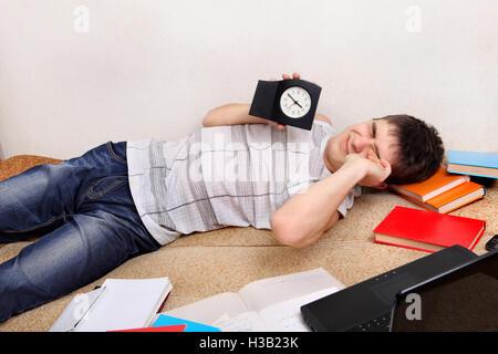 Tired Teenager on Sofa - Stock Photo