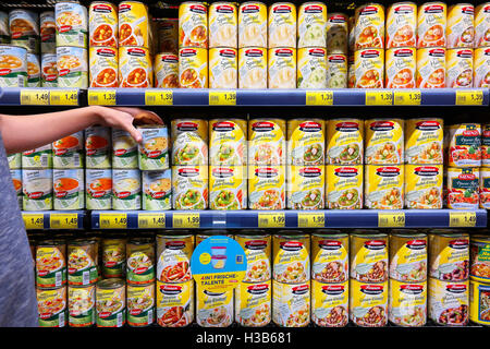 Canned food products in a supermarket. - Stock Photo