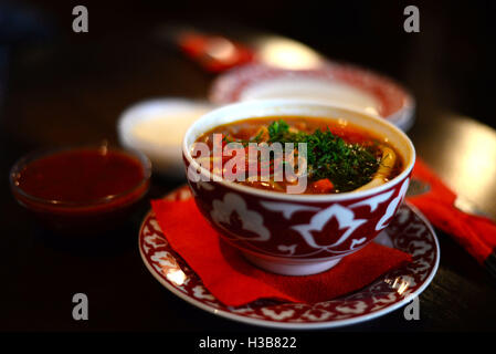 Uzbek lagman with meat in an earthenware cup - Stock Photo