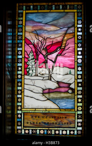 Stained glass window in the Episcopal Chapel of the Transfiguration, Grand Teton National Park, Wyoming, USA. - Stock Photo
