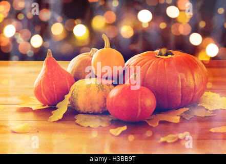 close up of halloween pumpkins on wooden table - Stock Photo