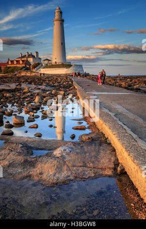 St Mary's Lighthouse north of Whitley Bay on the  North East coast of  England. At low tide. - Stock Photo
