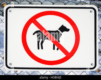 No dogs allowed sign on a fence - Stock Photo