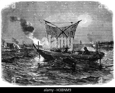 A fishing boat at night in the Bay of Jeddo, a bay in Japan visited by Commodore Matthew Perry, (1794 – 1858) who - Stock Photo