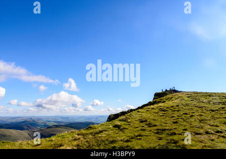 People at the summit of Cadair Idris mountain range in the Snowdonia National park in Wales, UK - Stock Photo