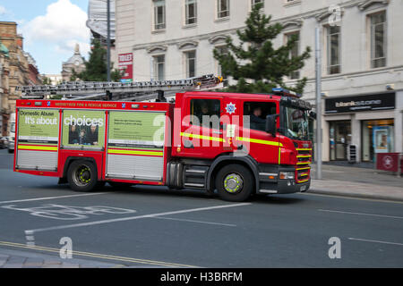 Responding emergency Fire & Rescue vehicle, fire, truck, emergency, vehicle, rescue, car, firefighter, safety, engine, - Stock Photo