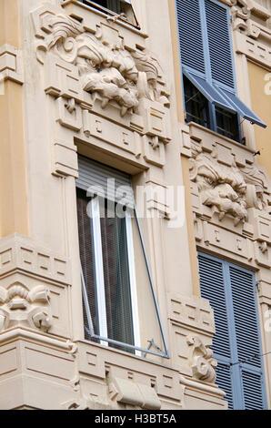 Bizarre details on apartment building, Genoa Italy - Stock Photo