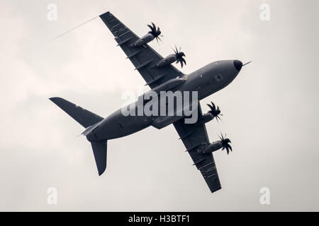 An Airbus A400M Atlas military transport aircraft performs at the Farnborough Air Show 2014. - Stock Photo