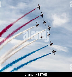 The Red Arrows perform aerobatic at Farnborough Air Show - Stock Photo