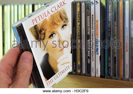 2002 Petula Clark The Ultimate Collection CD being chosen from a shelf of other CD's - Stock Photo