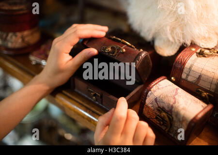 Close-up of hands opening a wooden jeweler box - Stock Photo