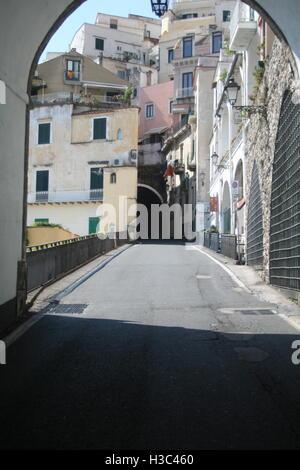 A small narrow street, in the Amalfi Coast area of Naples, Italy, taken through a tunnel - Stock Photo