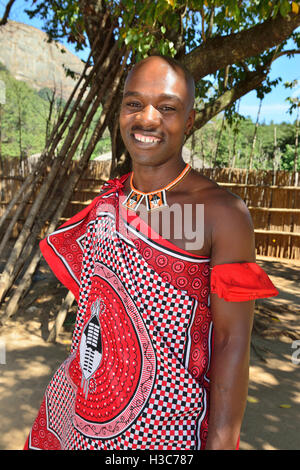 Swazi man guide in traditional dress in the  Mantenga Cultural Village,  Ezulwini Valley , Swaziland - Stock Photo