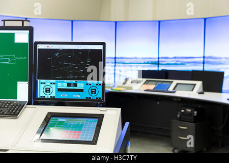 An air traffic controller is directing flights during a working day at Bullgaria's Air Traffic Services Authority - Stock Photo