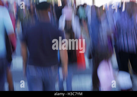 Blurred crowd of people walking down a street fair in New York City. Abstract design concept. In camera out of focus - Stock Photo