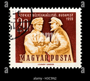 Postage stamp from Hungary depicting Szamuely and Lenin, Soviet stamp exhibition in Budapest, 1959. - Stock Photo
