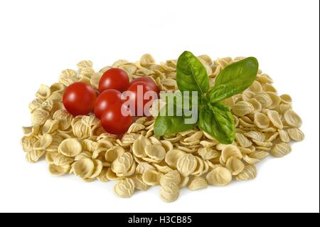 Orecchiette tomatoes and basil isolated on white - Stock Photo