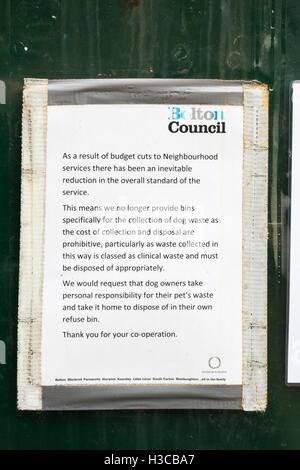 Publically posed notice near Smithills Hall, Bolton, regarding the ending of dog waste collection due to austerity - Stock Photo