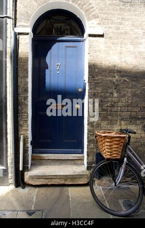 Bicycle with basket at front outside house in Cambridge street - Stock Photo