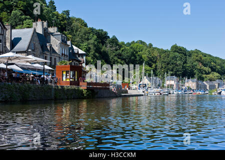 alfresco dining on the banks of the River Rance at Dinan Brittany - Stock Photo