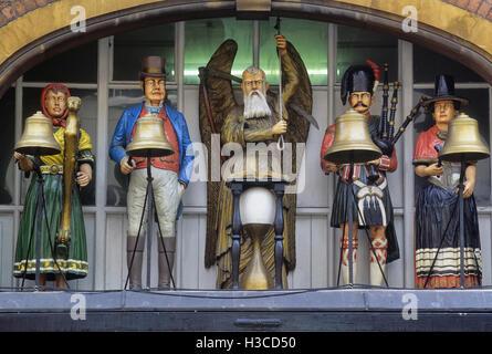 The figures of Baker's Clock, above the Edwardian shopfront of GA Baker & Son, in Southgate Street, Gloucester. - Stock Photo