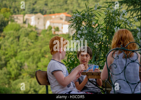 Children playing card game outdoors - Stock Photo