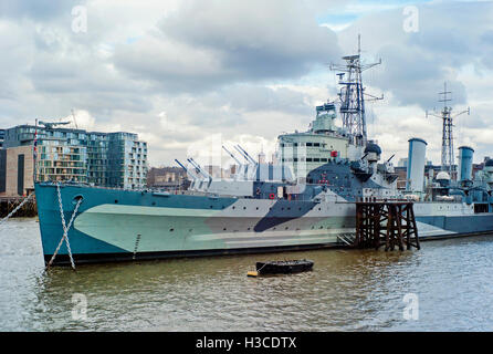 HMS Belfast moored on the Thames - Stock Photo