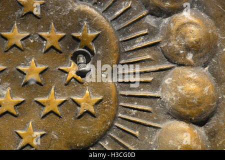 A bolt is embedded into a bronze shield recovered from the Murrah Federal Building, which was blown up in an act - Stock Photo