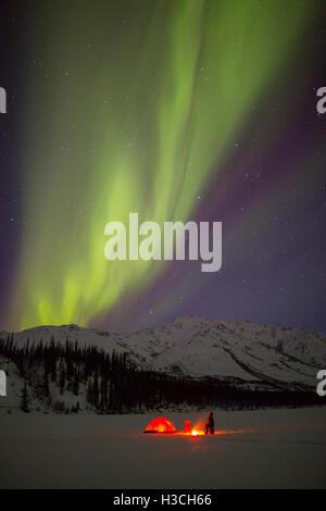 Camping under the Aurora Borealis in the Brooks Range, Alaska. - Stock Photo