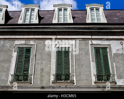 Old building with Green Shutters in the French Quarter of New Orleans LA - Stock Photo