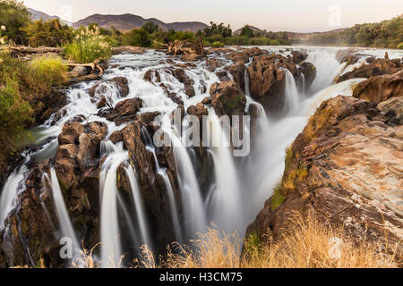 Multiple streams comprise the Epupa falls, on the Kunene river in the Kaokoveld of Northern Namibia, on the border - Stock Photo