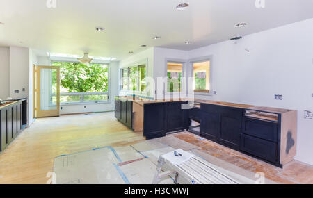 Kitchen cabinet installation - Stock Photo