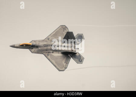 Low angle view of fighter plane flying in sky - Stock Photo