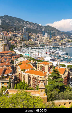 Monte Carlo city panorama. View of luxury yachts and apartments in harbor of Monaco, Cote d'Azur - Stock Photo