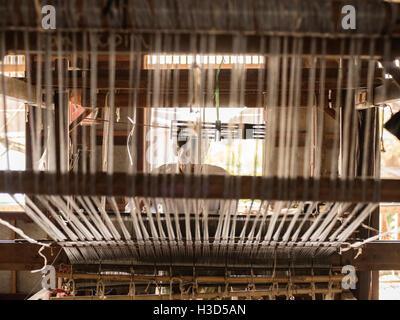 A silk weaver in Inle Lake, Myanmar - Stock Photo