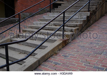 Concrete stairs with metal railings flanked by red bricks along Main Street in Galena, Illinois. - Stock Photo