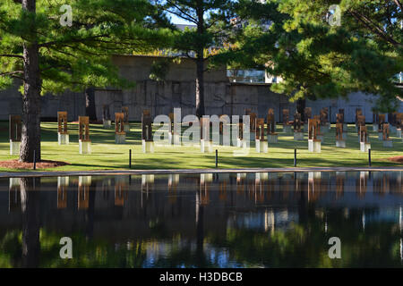 A field of empty chairs with smaller ones for the children represent those killed when a bomb destroyed the Murrah - Stock Photo