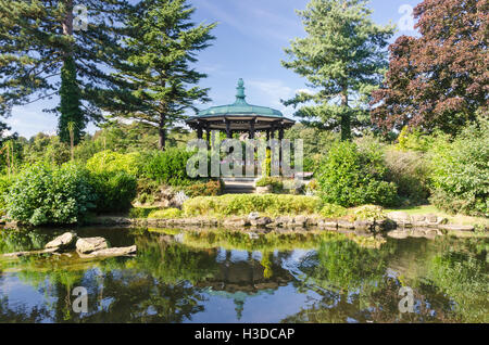 Banstand overlooking the lake at Belper River Gardens in Belper, Derbyshire - Stock Photo
