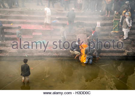 Bodies being prepared for cremation in Pashupatinth Temple on the banks of the Bagmati River. - Stock Photo