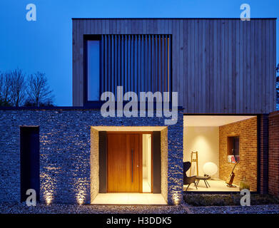 Dusk Elevation Of House Entrance Illuminated View Into Livingroom Cheeran