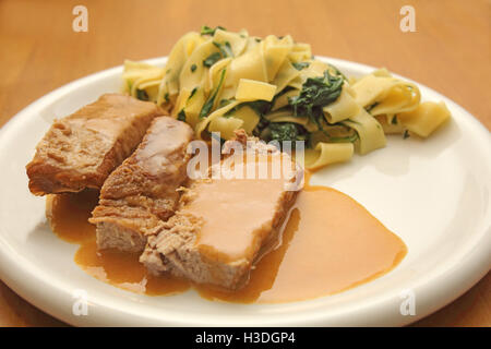 Veal roast with Tagliatelle noodles - Stock Photo