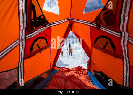 Snowboarders touring out of base camp in Canada - Stock Photo
