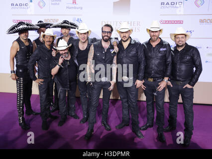 Hamburg, Germany. 16th Oct, 2016. German band BossHoss arrive with lead singer Alec Voelkel at the German Radio - Stock Photo
