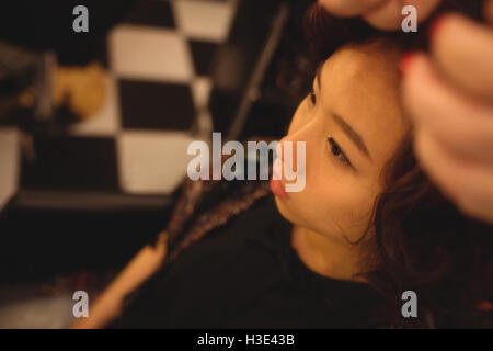 Stylish woman getting her hair done - Stock Photo
