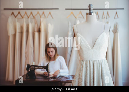 Couture hanging on mannequin - Stock Photo