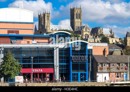 View of historic Lincoln Cathedral above modern buildings located on Brayford Pool, Lincoln, Lincolnshire, England - Stock Photo